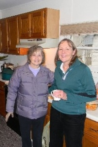 Billie Middaugh and Sue Lockett enjoy some hot apple cider